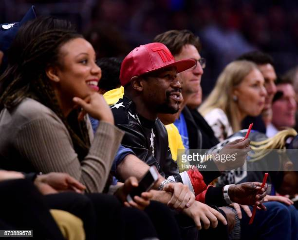 Floyd Mayweather smiles as he watches the game between the Philadelphia 76ers and the LA Clippers at Staples Center on November 13 2017 in Los...