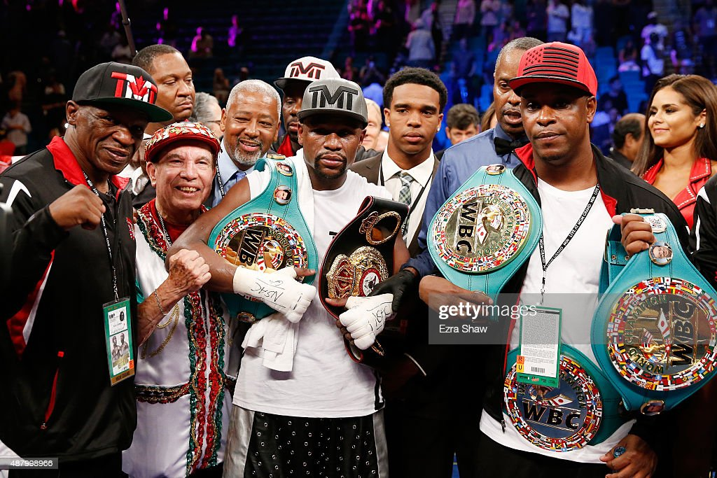 Floyd Mayweather Sr., Rafael Garcia, Floyd Mayweather Jr. and DeJuan Blake pose in the ring following their WBC/WBA welterweight title fight against Andre Berto at MGM Grand Garden Arena on September 12, 2015 in Las Vegas, Nevada. Mayweather won by unanimous decision.