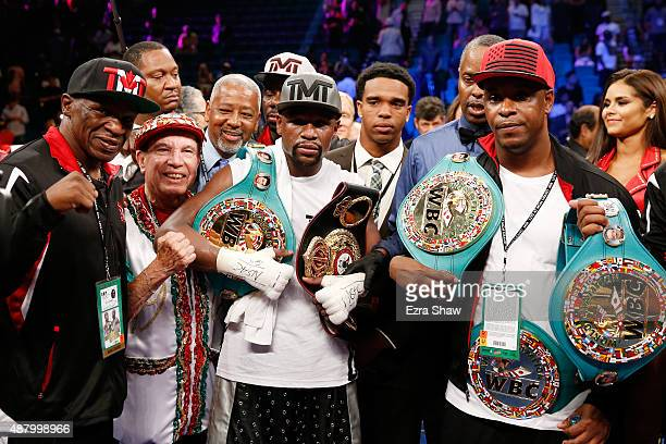 Floyd Mayweather Sr., Rafael Garcia, Floyd Mayweather Jr. And DeJuan Blake pose in the ring following their WBC/WBA welterweight title fight against...