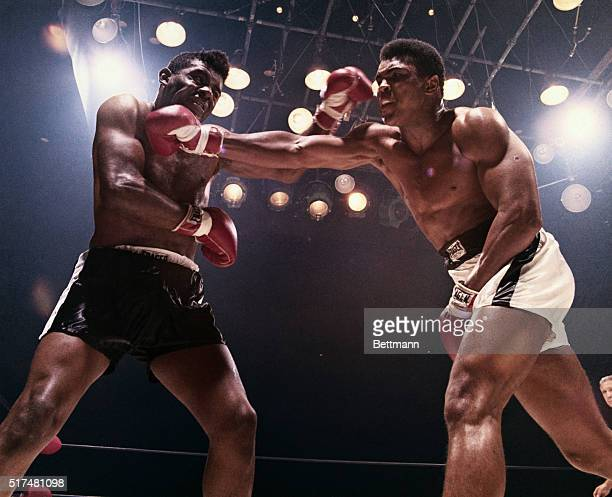 Floyd Patterson and Muhammad Ali each land a blow on the other. Ali won and retained his title of heavyweight champion.