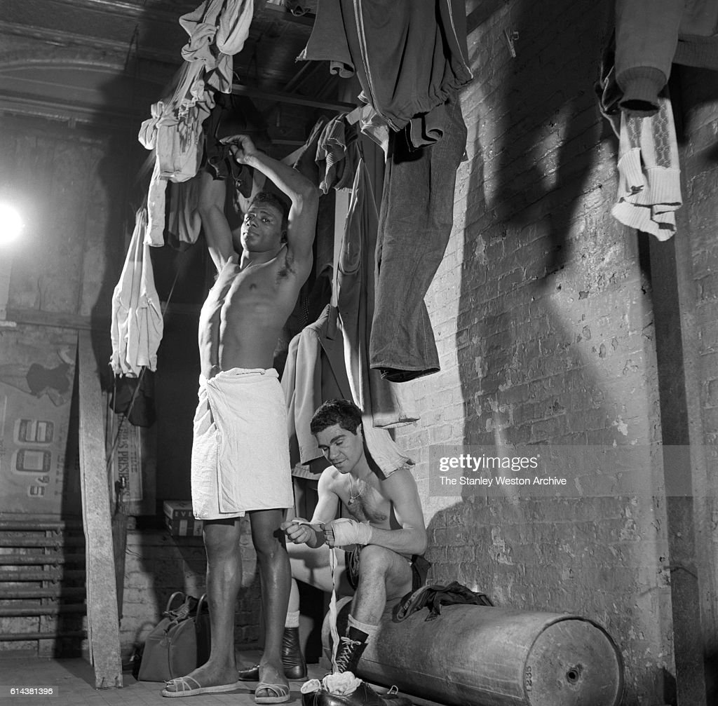 Floyd Patterson hangs up some clothes after a shower at the Gramercy Gym on 14th Street, New York, New York, on January 01, 1954.