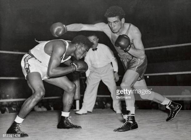 Floyd Patterson USA ducks under a swing by Omar Tebbeka of France during their Olympic Middleweight boxing bout in Helsinki on Wednesday Patterson...