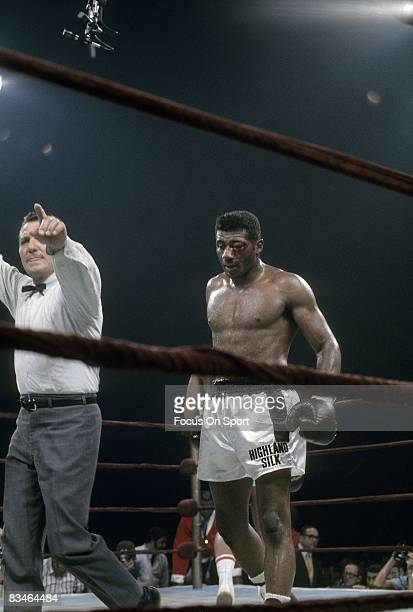 Floyd Patterson with his left eye puffy and bleeding heads toward his conner between rounds v Muhammad Ali during their heavyweight fight on...