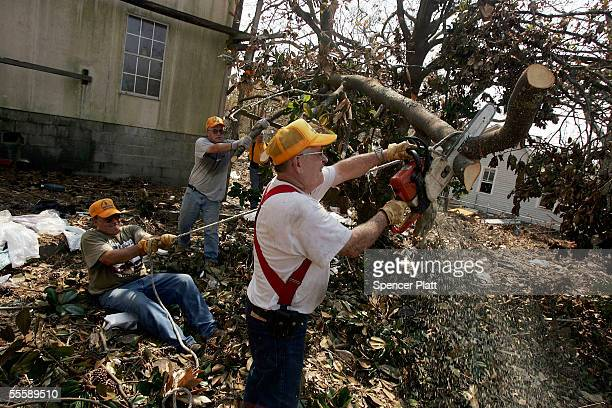 Floyd Smith one of numerous volunteers with the Southern Baptist Convention based in Kansas and Nebraska helps clear debris from a yard September 14...