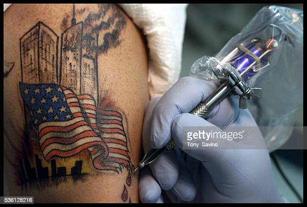 Floyd Storms of Middletown has a tatoo applied depicting the World Trade Center under attack by tatoo artist Glenn Broker owner of Class Act Tatoos