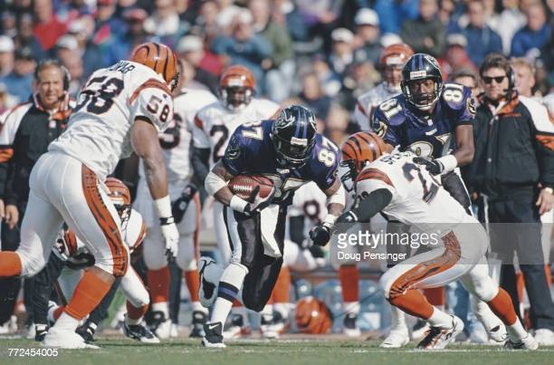 Floyd Turner Wide Receiver for the Baltimore Ravens running the ball as Jimmy Spencer Defensive Back for the Cincinnati Bengals attempts to tackle...