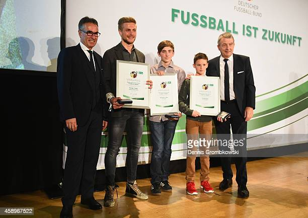 Flrorian Trinks Benjamin Jaeger and Till Bartlog pose during the Club 100/Fair ist mehr Award Ceremony at Rathaus Nuernberg on November 14 2014 in...