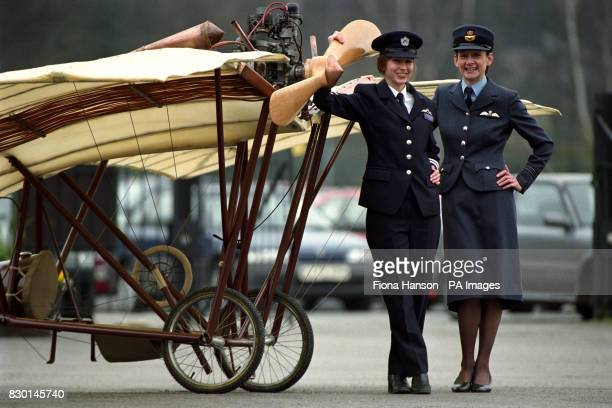 Flt Lt Julie Gibson right the first fulltime RAF operational woman pilot with Carly Childs a pilot with British Airways in front of a reproduction of...