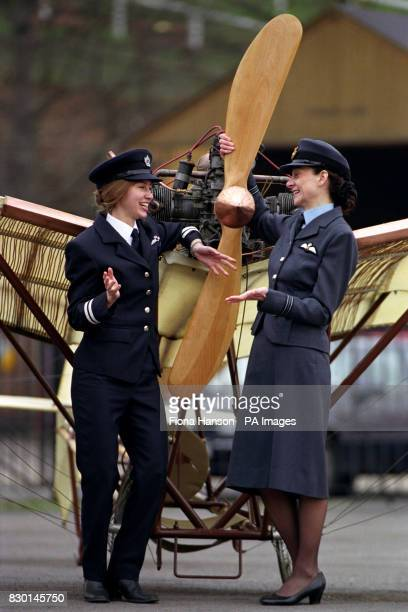 Flt Lt Julie Gibson the first fulltime RAF operational woman pilot with Carly Childs a pilot with British Airways in front of a reproduction of a...