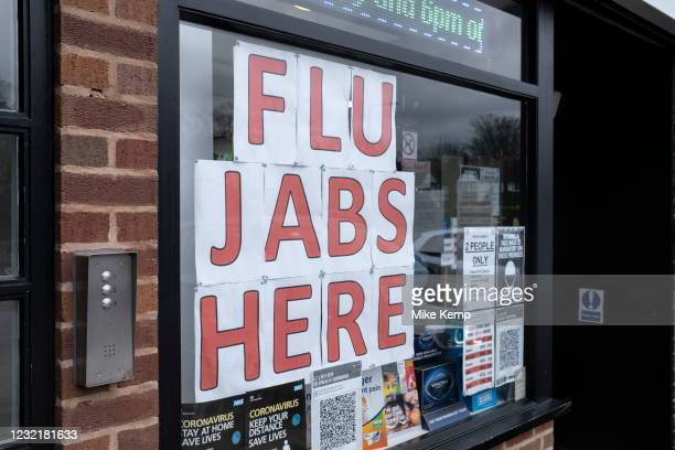 Flu jabs here sign in a pharmacy window on 7th February 2021 in Birmingham, United Kingdom. It is standard procedure each year for the NHS to offer...