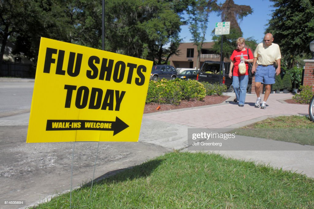 Flu shots sign at the Farmers Market in Winter Park : News Photo