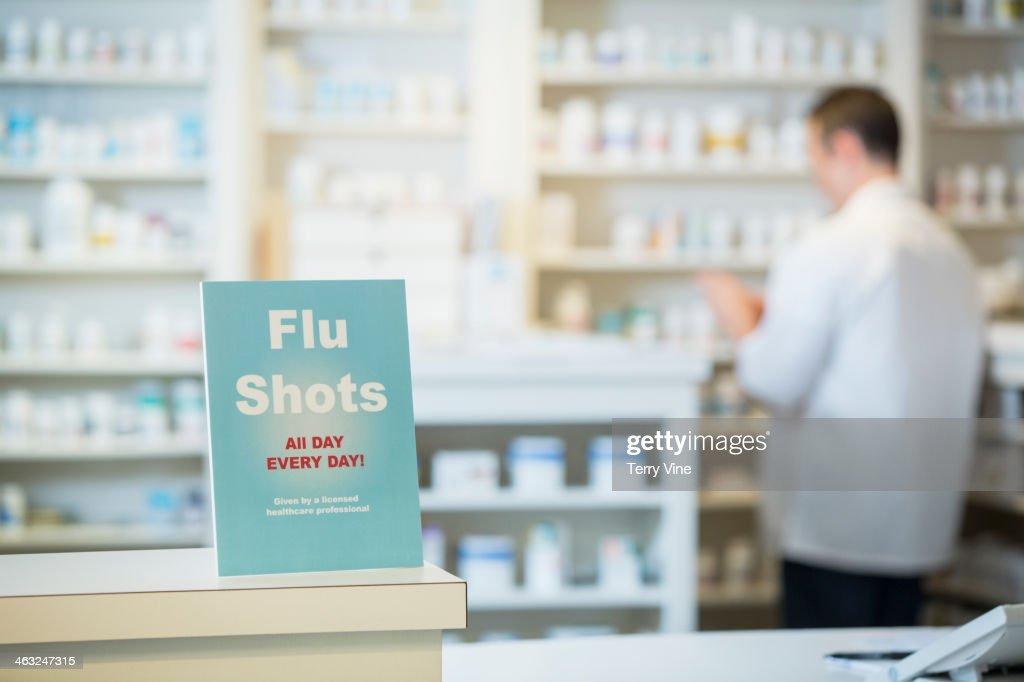Flu shots sign in pharmacy : Stock Photo