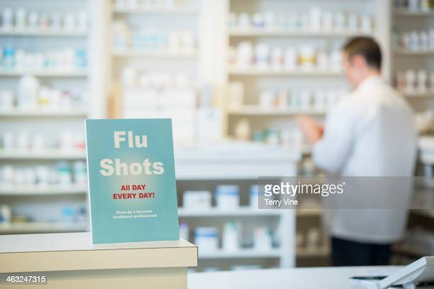 Flu shots sign in pharmacy