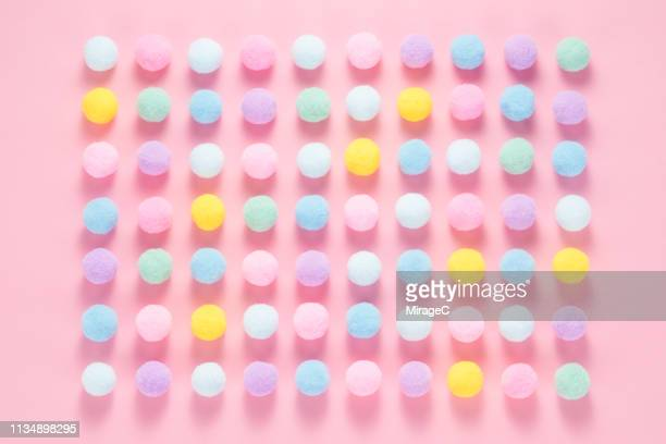 fluffy balls arrangement on pink - pom pom stock pictures, royalty-free photos & images