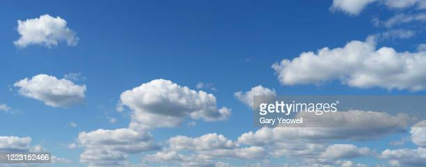 fluffy clouds against blue sky - cloudscape stock pictures, royalty-free photos & images