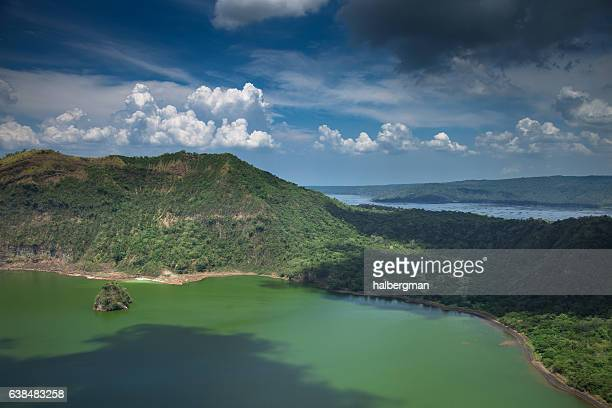 fluffy clouds over taal lake - taal volcano stock photos and pictures