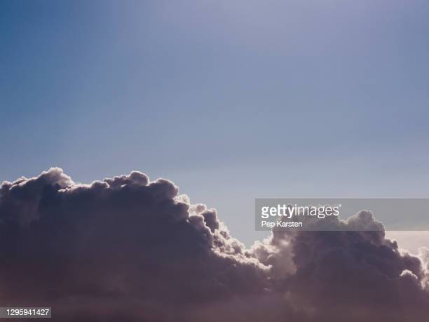 fluffy cumulus clouds in sunny blue sky - alpes maritimes stock pictures, royalty-free photos & images