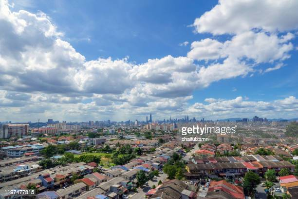 fluffy of monsoon clouds over downtown kuala lumpur, malaysia. - shaifulzamri stock pictures, royalty-free photos & images