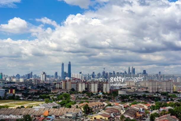 fluffy of monsoon clouds over downtown kuala lumpur. - shaifulzamri stock pictures, royalty-free photos & images