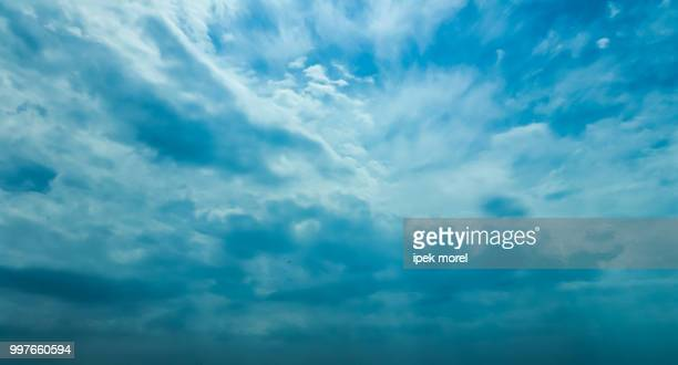 fluffy rain clouds - ipek morel stock pictures, royalty-free photos & images