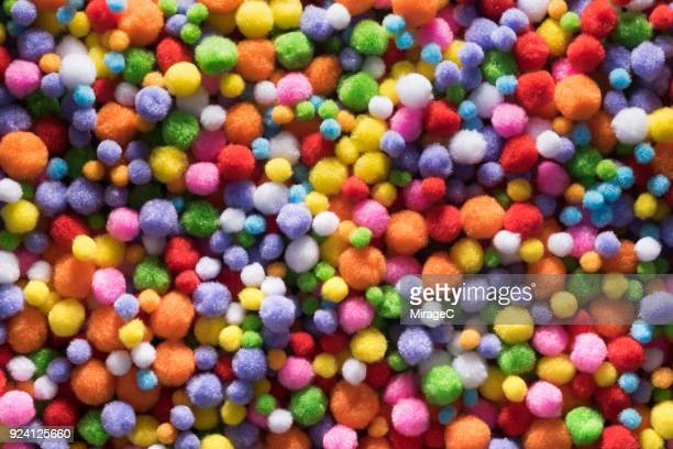 fluffy soft fabric balls - pom pom stock pictures, royalty-free photos & images