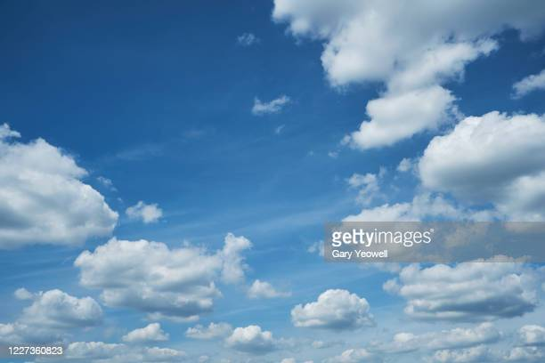 fluffy white clouds and blue sky - cloudscape stock pictures, royalty-free photos & images