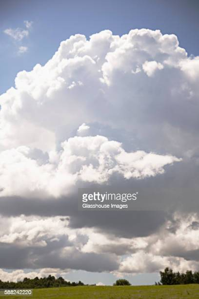 Fluffy White Clouds and Rural Landscape