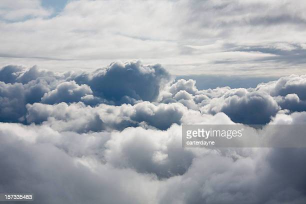 fluffy white clouds from above - wolk stockfoto's en -beelden