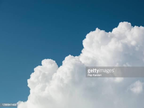 fluffy white clouds in sunny blue sky - alpes maritimes stock pictures, royalty-free photos & images