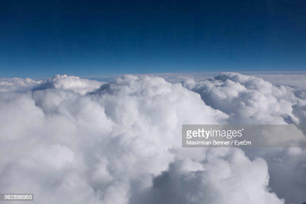 Fluffy White Cloudscape Against Blue Sky