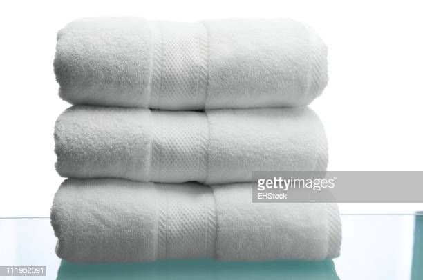 Fluffy White Towels on Reflective Surface