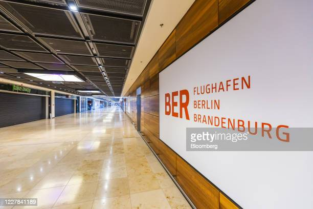 Flughafen Berlin Brandenburg GmbH sign sits on display during a passenger check-in test run demonstration at Berlin Brandenburg Airport in Berlin,...