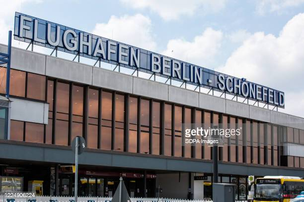 Flughafen Berlin - Schoenefeld sign at the main entrance to the Schoenefeld Airport . Berlin Schoenefeld Airport is the secondary international...