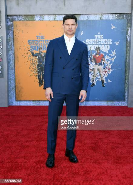 """Flula Borg attends the Warner Bros. Premiere of """"The Suicide Squad"""" at Regency Village Theatre on August 02, 2021 in Los Angeles, California."""
