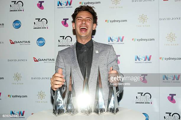 Flume poses in the awards room with his ARIA awards for Best Independent Release Best Pop Release Best Dance Release Best Male Artist and Telstra...