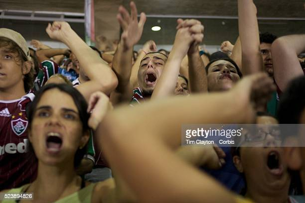 Fluminense fans support their side with load singing during the Fluminense V Palmeiras Futebol Brasileirao League match at the Jornalista M��rio...