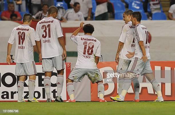 Fluminense's Wellington Nem dances in celebration after scoring against Santos FC during thei Brazilian Championship football match at the Joao...