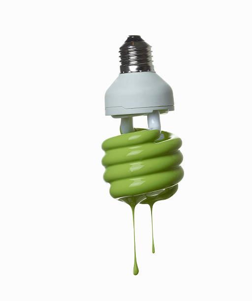 Fluorescent light bulb dripping in green