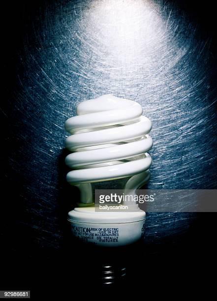 Fluorescent Light Bulb on Stainless Steel.