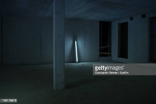 Fluorescent Light By Wall In Parking Lot