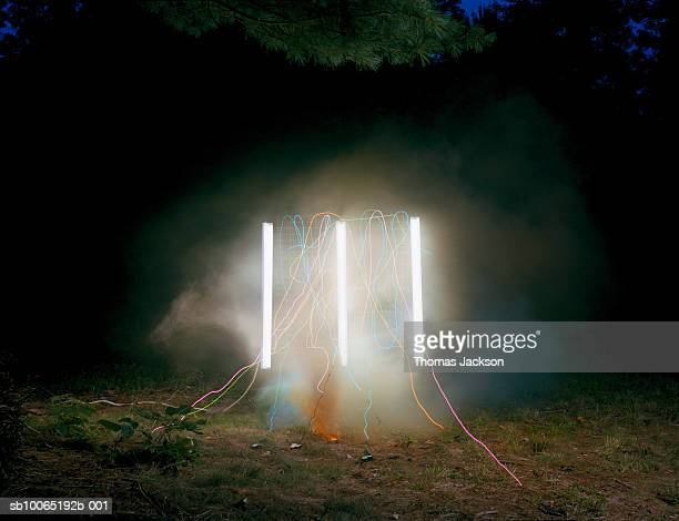 fluorescent light with smoke and glowing wire - fluorescent light stock pictures, royalty-free photos & images