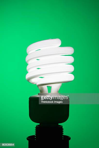 fluorescent lightbulb - canadian football league stock photos and pictures