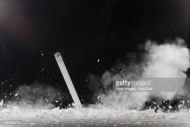 a fluorescent tube shattering - fluorescent light stock pictures, royalty-free photos & images