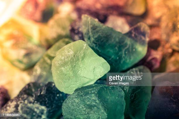 fluorite cabbing rough gems and minerals - fluorite stock pictures, royalty-free photos & images