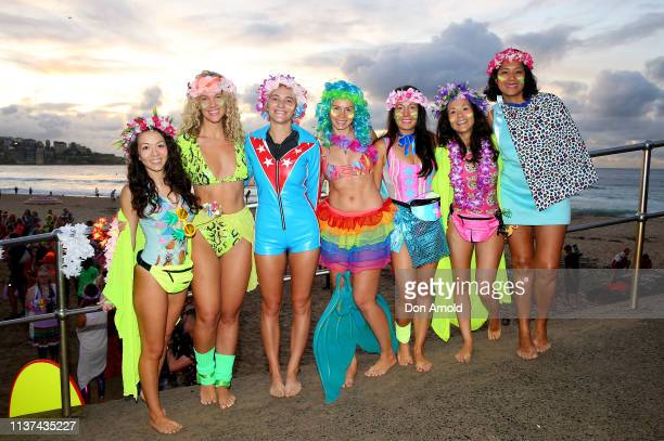 Fluro clad girls pose on March 22 2019 in Sydney Australia Surfers gather to celebrate five years of OneWave a not for profit that encourages people...