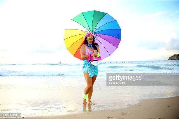 A fluro clad Jodi Hooker poses on the Bondi Beach shoreline on March 22 2019 in Sydney Australia Surfers gather to celebrate five years of OneWave a...