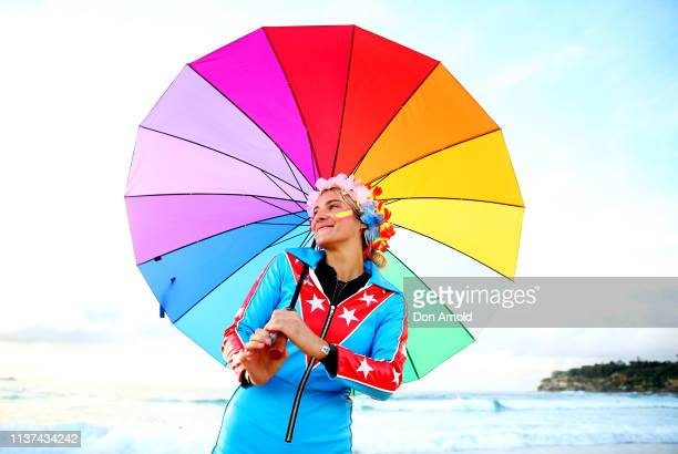 A fluro clad young girl poses on the Bondi Beach shoreline on March 22 2019 in Sydney Australia Surfers gather to celebrate five years of OneWave a...