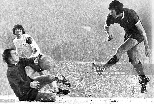 A flurry of snow as Liverpool�s John Toshack lets fly straight at diving Derby goalie Colin Boulton