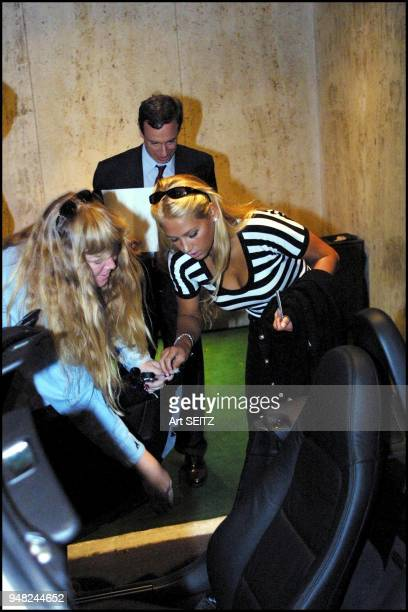 Flushing Meadow NY 06/09/01 Anna Kournikova signing the interior of a Z3 BMW for Lycos Promotion winner Kelly Mayer Ofallon