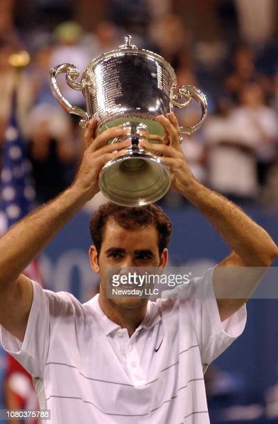 Pete Sampras raises his trophy up over his head after defeating Andre Agassi 63 64 57 64 in the men's singles finals to win the US Open Championship...